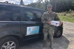 Military photo with care package