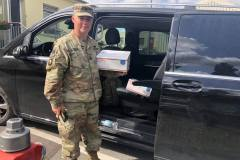 Military member with care package