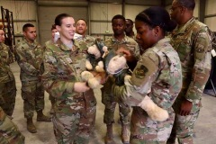 Military members with bear care package